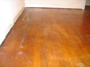 Scratches and marks on natural wooden floor